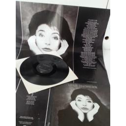 KATE BUSH this woman's work, limited edition, fold out poster sleeve, 12EM 119