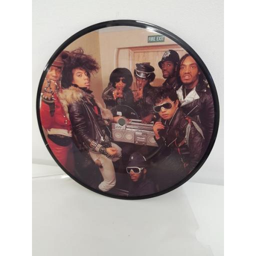 "SOLD : GRANDMASTER AND MELLE MEL, white lines don't don't do it, B side white lines don't don't do it instrumental, SHPX 130, PICTURE DISC 7"" single"