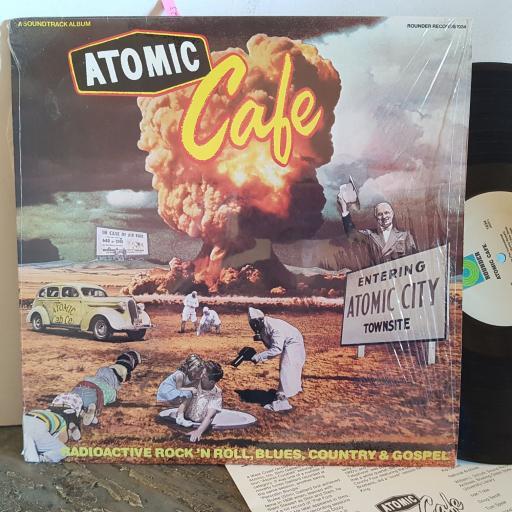 "ATOMIC CAFE radioactive rock n roll, blues, country & gospel. Featuring Sonny Boy Williamson, The Buchanan Bros, Skip Stanley etc. VINYL 12"" LP. RR1034"