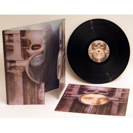 Emerson Lake and Palmer BRAIN SALAD SURGERY. Rare complete fold out die-cut cover design by H.R Giger, with fold out poster